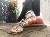 Feet In Coloured Sandals